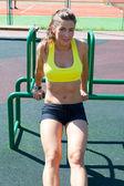 Woman stretching on playground — Zdjęcie stockowe