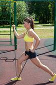 Woman with gym band — Zdjęcie stockowe