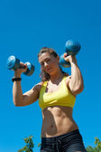 Sport woman with dumbbells — Stock Photo