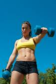 Woman with dumbbells on playground — Foto de Stock