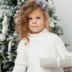 Girl near Christmas tree — Stock Photo #60281657