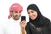 Arab couple sharing social media on the smart phone — Stock Photo
