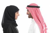 Side view of an arab saudi couple looking each other — Stock Photo