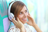 Happy woman with headphones listening to the music — Stock Photo