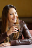 Happy woman holding a refreshment in a restaurant — Stock Photo