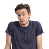 Front portrait of a young man doubting shrugging shoulders — Stock Photo
