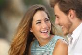Funny couple laughing with a white perfect smile — Stock Photo