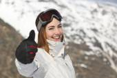 Positive skier woman gesturing thumb up in winter — Stock Photo
