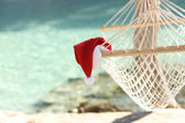 Hammock on a tropical beach resort in christmas holidays — Stock Photo