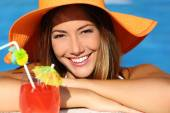 Happy woman with perfect white smile in vacations bathing in a pool — Stock Photo