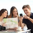 Group of young tourist friends consulting gps map in a smart phone — Stock Photo #64410537