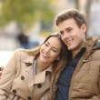 Couple in love hugging in an urban park — Stock Photo #64828091