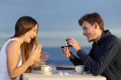Boyfriend requesting hand of his girlfriend with a engagement ring — Stock Photo