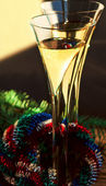Two flutes of Champagne, Christmas wreath and spruce branch — Stock Photo