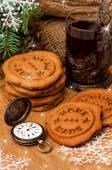 Gingerbread christmas cookies, vintage swiss watch, tea — Stock Photo