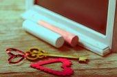 Saint Valentines decoration: heart and key, black board and chalk — Stock Photo