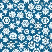 Seamless pattern with snowflakes on a blue background — Stock Vector