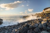 Rocky coastline of Tenerife and splatter at sunset — Stock Photo