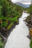 Highland rapid river Rauma crosses rocky riverside — Stock Photo