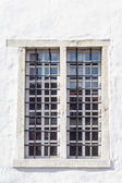 Medieval style window with iron grid — Stock Photo