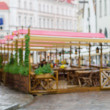 Blurred rainy background of classic european old town street — Stock Photo #75710389