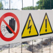 Warning signs on fence at construction site — Stock Photo #77257464