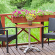 Outdoor terrace cafe table with two chairs — Stock Photo #78699968
