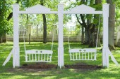 Vintage white wooden swing in the garden — Stock Photo