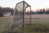Old rusty soccer goal on sunset, nostalgia concept — Stock Photo