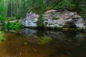 Sandstone outcrops reflection on water of Ahja river, Estonia — Stock Photo