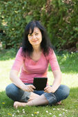 Woman reading ebook — Stock Photo
