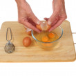 Hands cracking eggs — Stock Photo #54498417