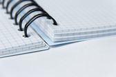 Spiral notepad on a white background — Stock Photo