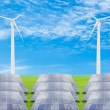 Solar panels and wind turbine on green grass field against blue — Stock Photo #57242997