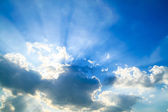 Beautiful blue sky with clouds and sun rays — 图库照片