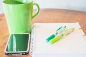 Creative work table with hot mug — Stock Photo