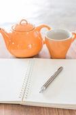 Work table with hot tea — Stok fotoğraf