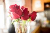 Beautiful red rose bouquet on vintage background — Stock Photo