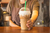 Plastic glass of iced coffee cappuccino — Stock Photo