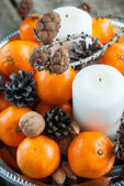 Holiday Composition with Tangerines, Pine cones, holiday decorat — Stock Photo