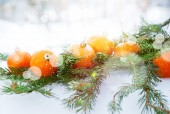 Greeting Card with Tangerines, boke and snowflakes — Stock Photo