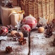 Vintage Christmas Gifts with Basket, Red balls, toys, toned — Stock Photo #58563595