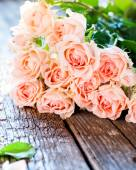 Bouquet of Pink Roses on Wooden Table — Stock Photo