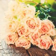 Bouquet of Tender Pink Roses in sunshine light, toned image — Stock Photo #62944805
