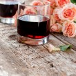 Glasses of Red Wine and Pink Roses on Wooden Background — Stock Photo #62945989