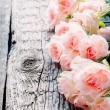 Pink Roses on Wooden Table, toned image square — Stock Photo #62946527