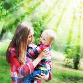 Mother with Boy playing in Park. Sunlight effects — Stock Photo