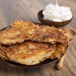 Potato pancakes with sour cream — Stock Photo #58305849