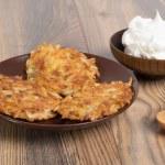 Potato pancakes with sour cream — Stock Photo #58306529