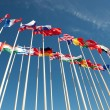Flags on flagpoles fluttering in the wind — Stock Photo #70036055